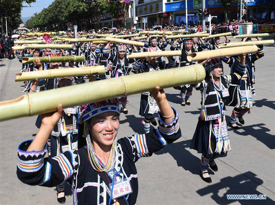 People take part in bamboo pole dance during a parade at Lancang Lahu Autonomous County in Pu\'er City, southwest China\'s Yunnan Province, Feb. 7, 2018. People of ethnic groups wearing their traditional festive costumes took part in a parade to celebrate the Chinese Lunar New Year in Lancang Lahu Autonomous County. (Xinhua/Yang Zongyou)