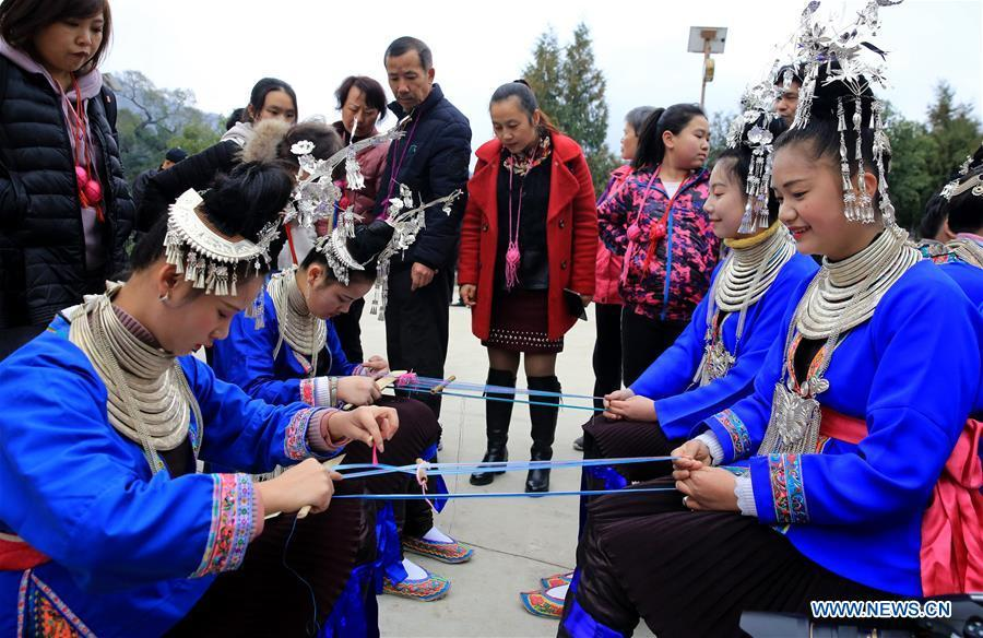 People of Dong ethnic group perform during the Spring Festival holiday in Dingdong Village of Qiandongnan Miao and Dong Autonomous Prefecture, southwest China\'s Guizhou Province, Feb. 8, 2019. (Xinhua/Long Tao)