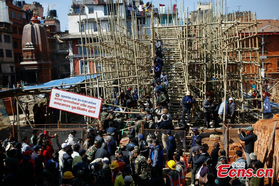People carry wooden pillars for erection at the reconstruction site of the Kasthamandap temple at Hanumandhoka Durbar Square in Kathmandu, Nepal, Feb. 10, 2019. A ceremony was held to keep the wooden pillars to reconstruct the Kasthamandap temple, which was destroyed during the 2015 earthquake. Kasthamandap (Kastha: wood, mandap: pavilion) temple is one of the oldest and historical building in Kathmandu. (Photo: China News Service/Pu Ladan)