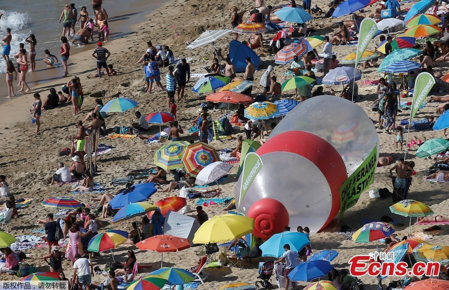 A giant plastic bottle is seen on a beach as part of a campaign by Greenpeace to warn of the presence of plastics on the coasts of Vina del Mar, Chile, Feb. 9, 2019. The campaign aims to end the flow of plastic into the oceans. (Photo/VCG)