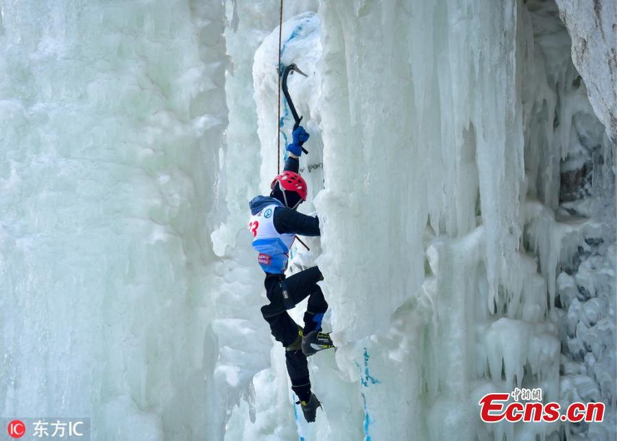 A participant ascends a frozen fall during a competition in Vladivostok, Russia, Feb. 9, 2019. (Photo/IC)