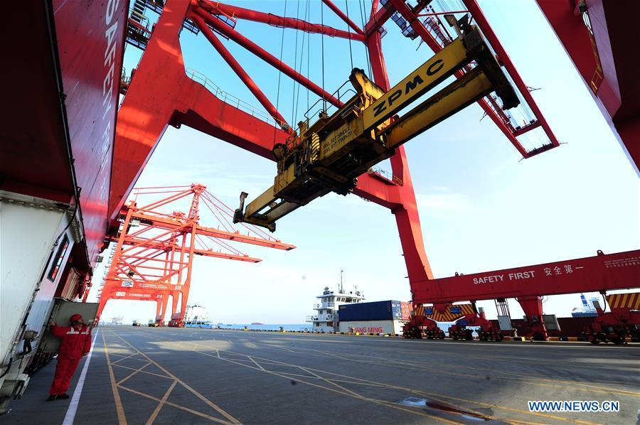 Gong Fuqiang, a crane driver, conducts security check for container loading at Zhenghe Xinggang Terminals of Taicang Port in Suzhou, east China\'s Jiangsu Province, Feb. 11, 2019, the first workday after Spring Festival holiday. (Xinhua/Ji Haixin)