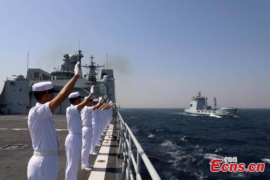 Soldiers on the PLA Navy ship Kunlun wave during the multinational military drill Peace-19 held in the waters off Karachi, Pakistan from Feb. 11 to 12. The drill undertook 23 programs including ship supply and maneuvers against a pirate attack (Photo: China News Service/Xue Chengqiang)