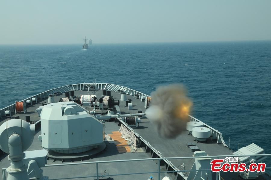 The PLA Navy ship Kunlun fires during the multinational military drill Peace-19 held in the waters off Karachi, Pakistan from Feb. 11 to 12. The drill undertook 23 programs including ship supply and maneuvers against a pirate attack (Photo: China News Service/Xue Chengqiang)
