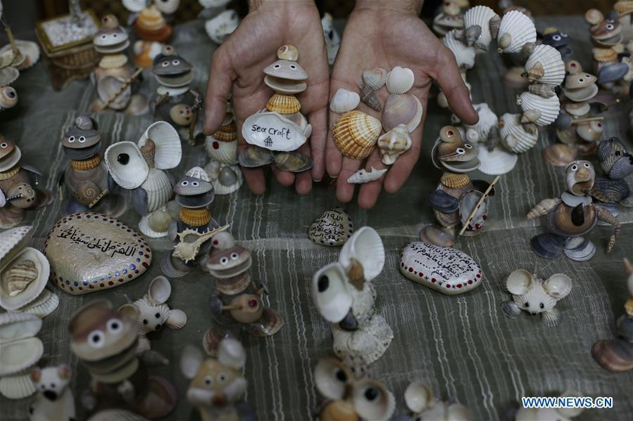 Palestinian young man Ahmed al-Madhoun, 31, displays art pieces he made with seashells at his house in Gaza City, on Feb. 10, 2019. A Palestinian young man from Gaza turns seashells into beautiful artifacts that adorn his home to satisfy his passion for this type of art. Using seashells he collects from Gaza beaches, 31-year-old Ahmed al-Madhoun makes various art pieces such as animals, birds and some funny characters. Al-Madhoun, who holds a college degree in radio and television engineering and works for a local telecommunication company, has been collecting multiple forms of seashells from the Gaza seashore for more than four years. The young man began the hobby of seashell art about a year and a half ago, and he already made large numbers of art pieces.  (Xinhua/Stringer)
