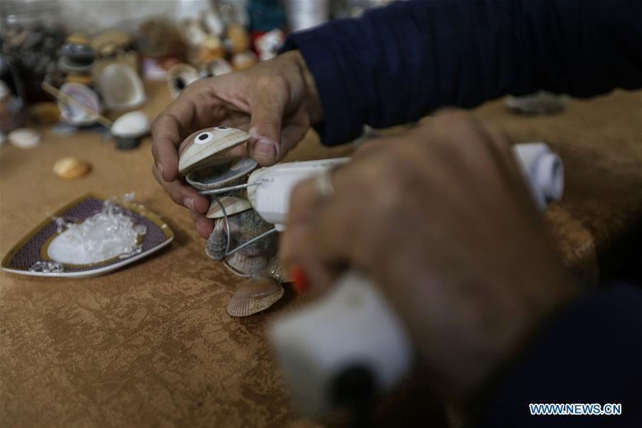 Palestinian young man Ahmed al-Madhoun, 31, makes an art piece with seashells at his house in Gaza City, on Feb. 10, 2019. A Palestinian young man from Gaza turns seashells into beautiful artifacts that adorn his home to satisfy his passion for this type of art. Using seashells he collects from Gaza beaches, 31-year-old Ahmed al-Madhoun makes various art pieces such as animals, birds and some funny characters. Al-Madhoun, who holds a college degree in radio and television engineering and works for a local telecommunication company, has been collecting multiple forms of seashells from the Gaza seashore for more than four years. The young man began the hobby of seashell art about a year and a half ago, and he already made large numbers of art pieces.  (Xinhua/Stringer)