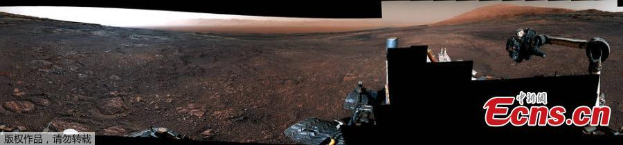 A panorama taken on December 19, 2018 by the Mast Camera (Mastcam) on NASA\'s Curiosity Mars rover. The rover\'s last drill location on Vera Rubin Ridge is visible, as well as the clay region it will spend the next year exploring. The scene combines 122 images taken with Mastcam\'s left-eye camera. (Photo/NASA)
