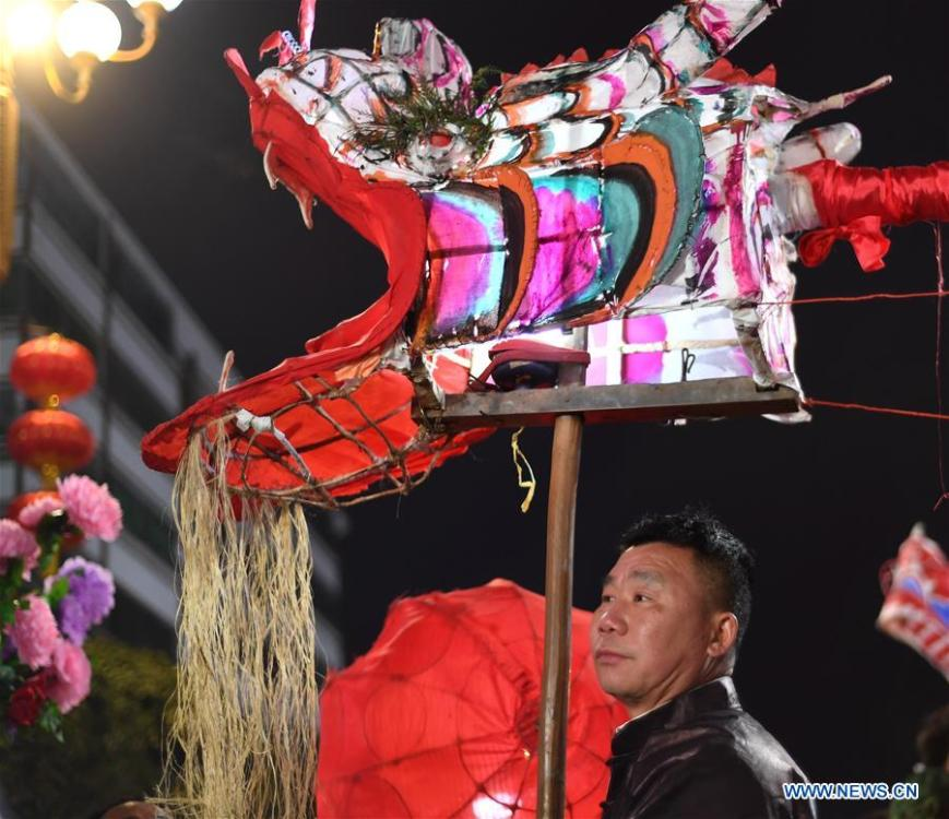 A man prepares to perform dragon dance to celebrate the upcoming Lantern Festival, which falls on Feb. 19 this year, in Shibing County, southwest China\'s Guizhou Province, Feb. 13, 2019. (Xinhua/Zong Hui)