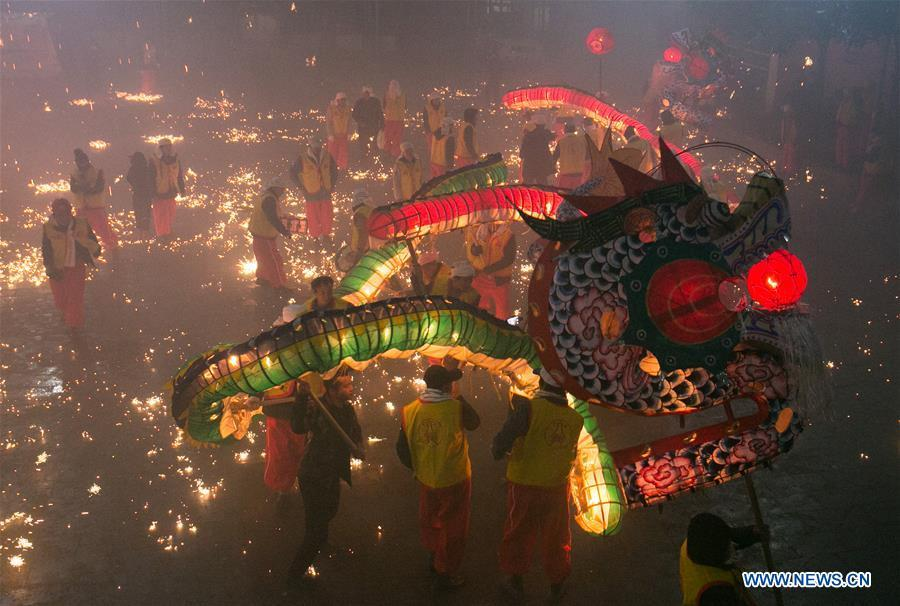 People perform dragon dance to celebrate the upcoming Lantern Festival, which falls on Feb. 19 this year, in Dafang County of Bijie City, southwest China\'s Guizhou Province, Feb. 13, 2019. (Xinhua/Luo Dafu)