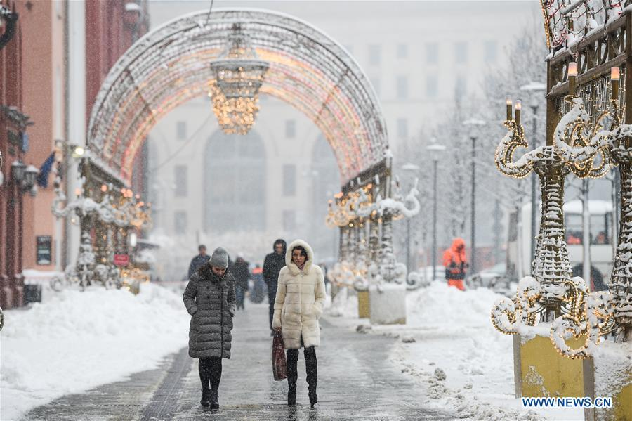 People walk in snow in Moscow, Russia, on Feb. 13. 2019. A recent snowfall resulted in 11 mm of precipitation in Moscow on Wednesday. (Xinhua/Evgeny Sinitsyn)