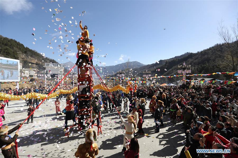 People of Tibetan ethnic group perform during the Shangjiu Festival at the foot of Jiajin Mountain in the Tibetan Township of Qiaoqi in Ya\'an City, southwest China\'s Sichuan Province, Feb. 13, 2019. The Shangjiu Festival, a traditional festival of the Tibetan people, is celebrated on the ninth day of the first lunar month to pray for a good harvest. (Xinhua/Jiang Hongjing)