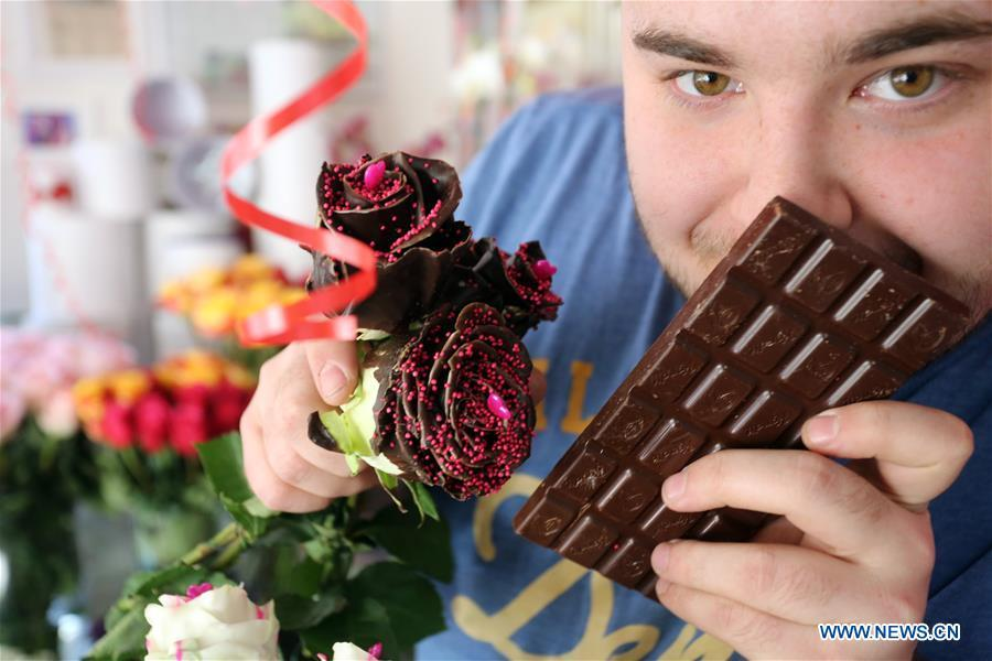 Ante Jurkovic, owner of a flower shop, poses with chocolate-coated roses in Rijeka, Croatia, Feb. 13, 2019. Jurkovic invented the technic to coat roses with chocolate in preparation for Valentine\'s Day. (Xinhua/Goran Kovacic)