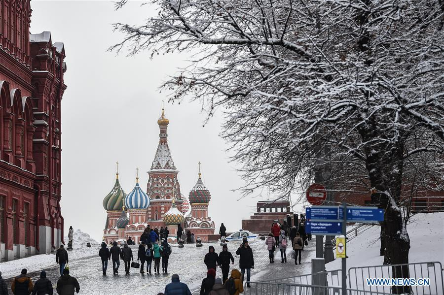 People visit the Red Square after snow in Moscow, Russia, on Feb. 13. 2019. A recent snowfall resulted in 11 mm of precipitation in Moscow on Wednesday. (Xinhua/Evgeny Sinitsyn)