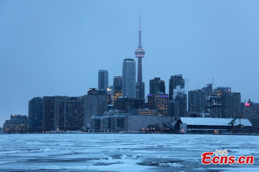 Toronto skyline is seen with floating ice on Lake Ontario in Toronto, Canada, on Feb. 13, 2019. A winter storm of a mix of snow, freezing rain and strong winds hit the Greater Toronto Area from Tuesday to Wednesday. (Photo/China News Service)