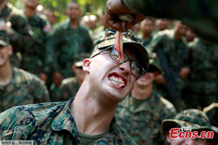 A soldier eats fresh meat during the Cobra Gold multilateral military exercise in Chanthaburi, Thailand, Feb. 14, 2019. (Photo/Agencies)
