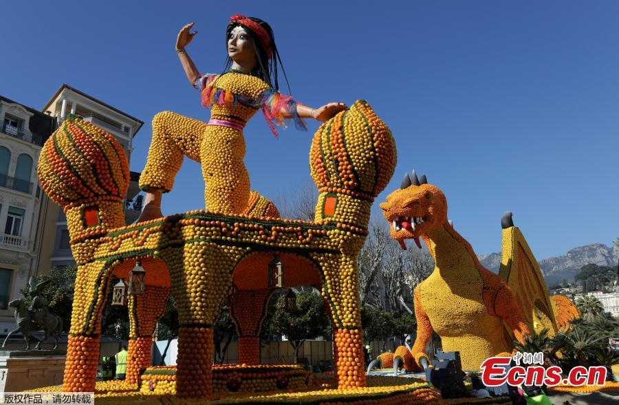 A sculpture made with lemons and oranges which depicts Scheherazade is seen during the 86th Lemon festival around the theme \