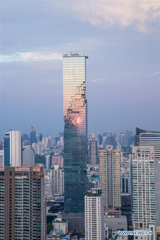 The photo shows King Power MahaNakhon skyscraper in sunset after rainfall in Bangkok, Thailand, Feb. 17, 2019. The rainfall helped to improve the air quality in Bangkok. (Xinhua/Zhang Keren)