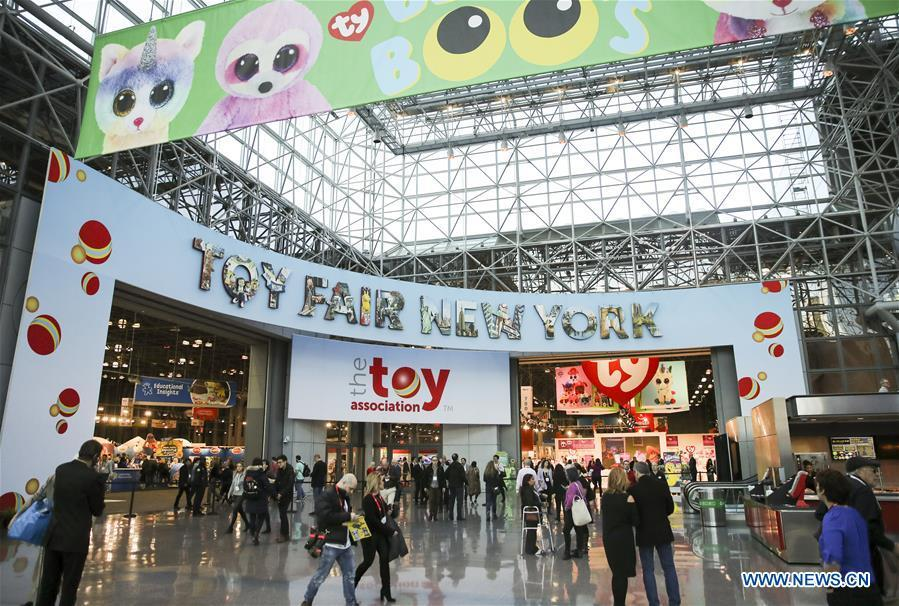 Visitors look around at the 116th Annual North American International Toy Fair at the Jacob K. Javits Convention Center in New York, the United States, Feb. 16, 2019. The toy fair, held from February 16 to 19 this year, gathered more than 1,000 toy exhibitors and hundreds of thousands of toys and youth entertainment products to retail outlets and trade guests from over 100 countries and regions. (Xinhua/Wang Ying)