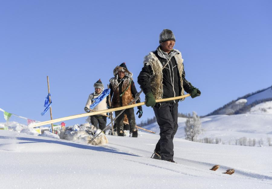 Villagers from Hemu take part in a traditional skiing activity. (Photo/Xinhua)