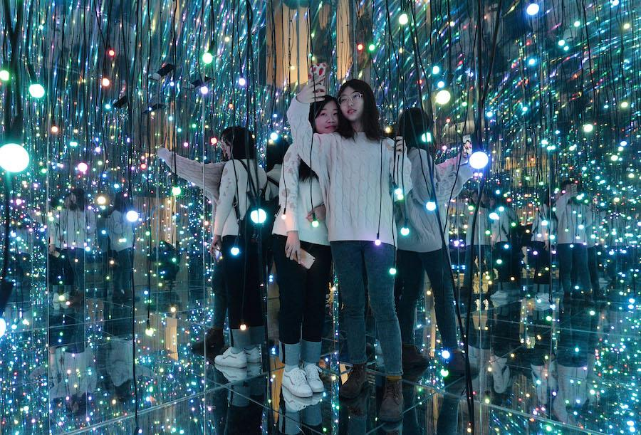 Two women take selfies at the 3D immersive pavilion in Handan city, Hebei province, on Feb 14, 2019. (Photo by Hao Qunying/Asianewsphoto)