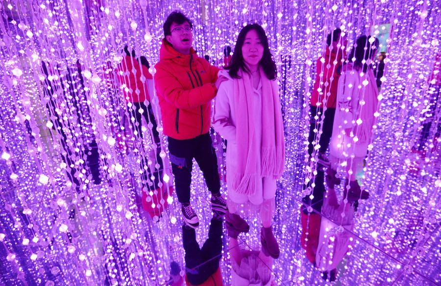 A couple visits the 3D immersive pavilion in Handan city, Hebei province, on Feb 14, 2019. (Photo by Hao Qunying/Asianewsphoto)
