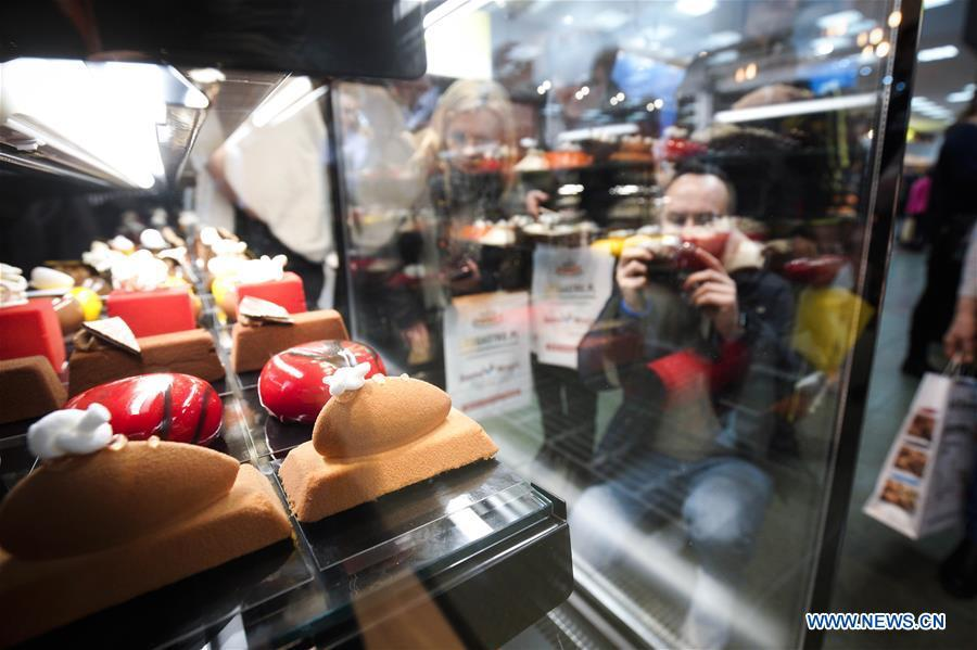 A man takes photos of handmade confectionery at the Expo Sweet in Warsaw, Poland, on Feb. 17, 2019. Expo Sweet, one of the largest confectionery and ice-cream fairs in Poland, is held in Warsaw from Feb. 17 to 20. (Xinhua/Jaap Arriens)