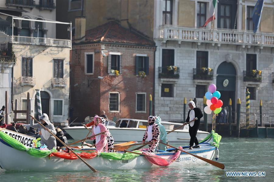 People participate in a water parade during the Venice Carnival in Venice, Italy, on Feb. 17, 2019. The Venice Carnival 2019 kicked off on Saturday and will last until March 5. (Xinhua/Cheng Tingting)