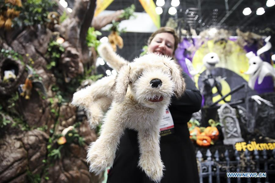 A sales person shows a stuffed toy at the 116th Annual North American International Toy Fair at the Jacob K. Javits Convention Center in New York, the United States, Feb. 16, 2019. The toy fair, held from February 16 to 19 this year, gathered more than 1,000 toy exhibitors and hundreds of thousands of toys and youth entertainment products to retail outlets and trade guests from over 100 countries and regions. (Xinhua/Wang Ying)
