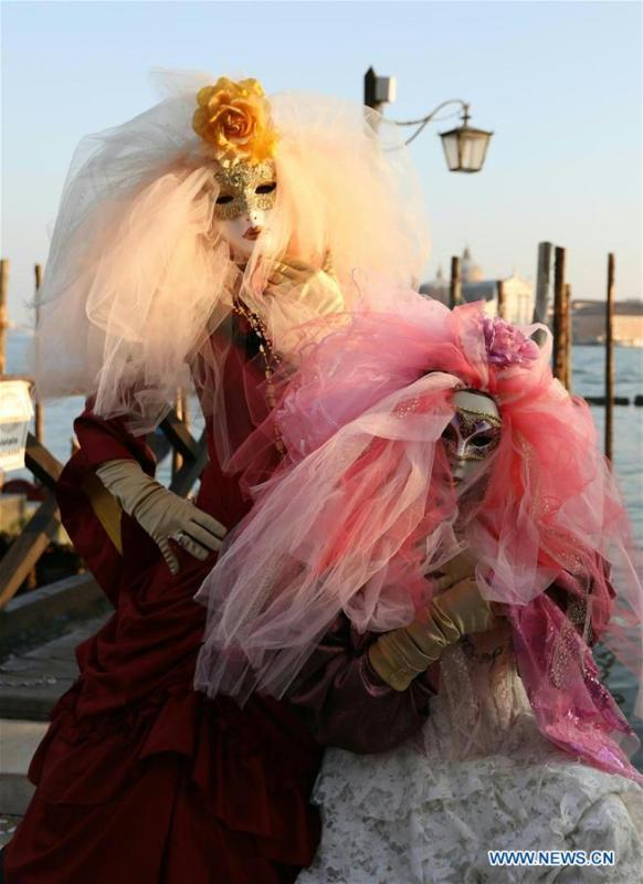 Revelers pose during the Venice Carnival in Venice, Italy, on Feb. 17, 2019. The Venice Carnival 2019 kicked off on Saturday and will last until March 5. (Xinhua/Cheng Tingting)
