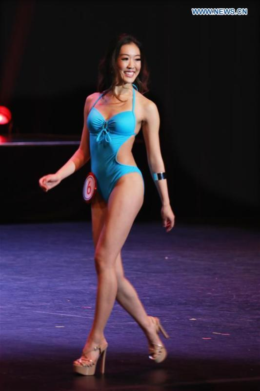 Champion of the 2019 Miss Chinatown U.S.A. Pageant Katherine Wu presents swimsuit during the competition in San Francisco, the United States, Feb. 16, 2019. A total of 12 contestants took part in the final competition organized by San Francisco Chinese Chamber of Commerce. (Xinhua/Liu Yilin)