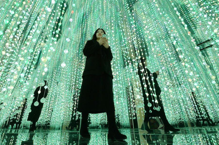 A woman takes photos at the 3D immersive pavilion in Handan city, Hebei province, on Feb 14, 2019. (Photo by Hao Qunying/Asianewsphoto)