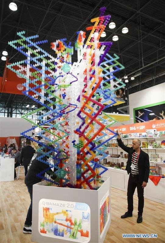Exhibitor representatives demonstrate a marbel maze game at the 116th Annual North American International Toy Fair at the Jacob K. Javits Convention Center in New York, the United States, Feb. 16, 2019. The toy fair, held from February 16 to 19 this year, gathered more than 1,000 toy exhibitors and hundreds of thousands of toys and youth entertainment products to retail outlets and trade guests from over 100 countries and regions. (Xinhua/Wang Ying)