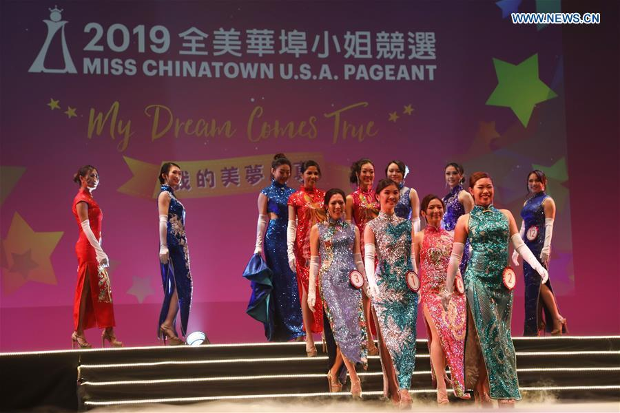 Contestants compete in the evening dress session during the final of the 2019 Miss Chinatown U.S.A. Pageant in San Francisco, the United States, Feb. 16, 2019. A total of 12 contestants took part in the final competition organized by San Francisco Chinese Chamber of Commerce. (Xinhua/Liu Yilin)