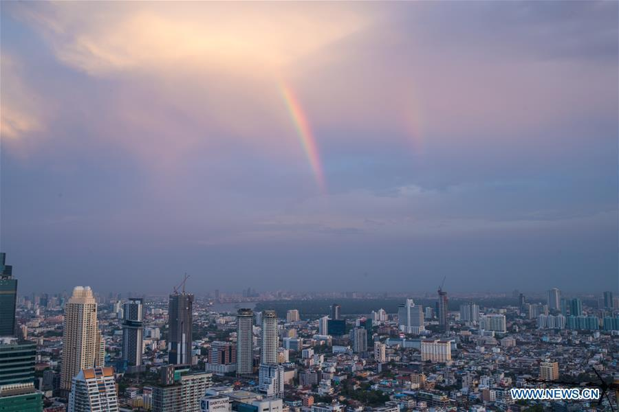 A rainbow appears in the sky after rainfall in Bangkok, Thailand, Feb. 17, 2019. The rainfall helped to improve the air quality in Bangkok. (Xinhua/Zhang Keren)