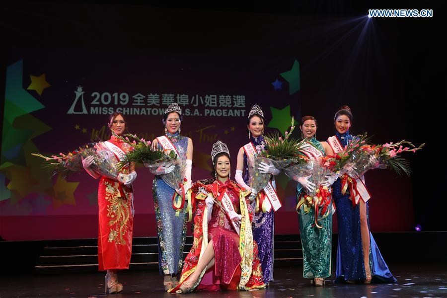 Prize winners pose for a group photo during the final of the 2019 Miss Chinatown U.S.A. Pageant in San Francisco, the United States, Feb. 16, 2019. A total of 12 contestants took part in the final competition organized by San Francisco Chinese Chamber of Commerce. (Xinhua/Liu Yilin)