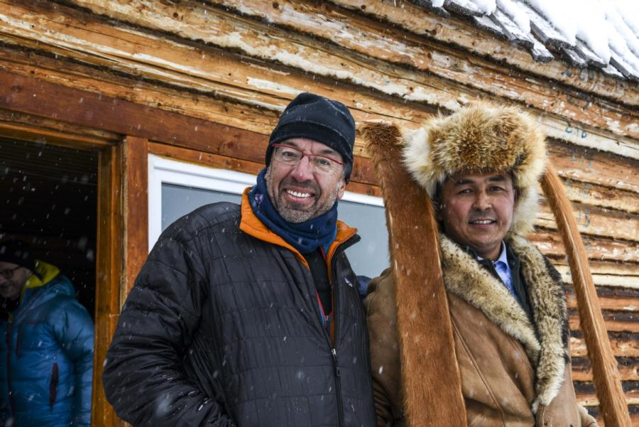 Bruno (left) and Mirbek (right) holding a pair of ancient fur skis. (Photo/Xinhua)