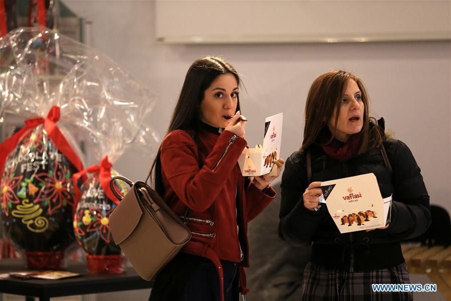 Visitors taste chocolate sweets during the Chocolate Festival in Athens, Greece, Feb. 16, 2019. The four-day festival, held from February 14 to 17, involved tasting sessions, workshops and children activities led by experts dedicated to the art of chocolate. (Xinhua/Marios Lolos)