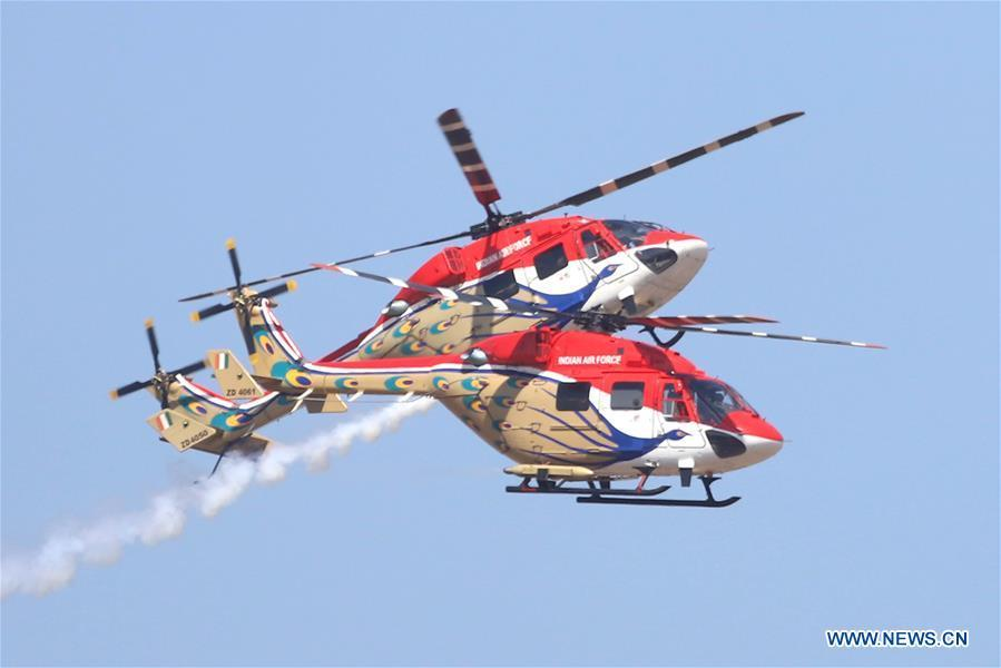 Indian Air Force Dhruv helicopters attend the Aero India Show 2019 rehearsal over the Yelahanka air base in Bangalore, India, on Feb. 18, 2019. The five-day Aero India Show 2019 will start on Feb. 20. (Xinhua)