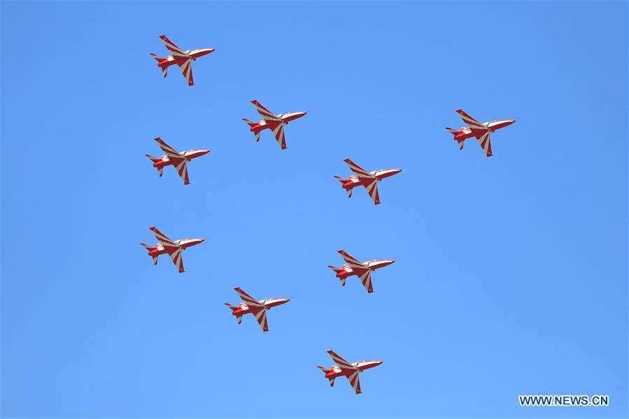 Indian Air Force Suryakiran aerobatic team attends the Aero India Show 2019 rehearsal over the Yelahanka air base in Bangalore, India, on Feb. 18, 2019. The five-day Aero India Show 2019 will start on Feb. 20. (Xinhua)