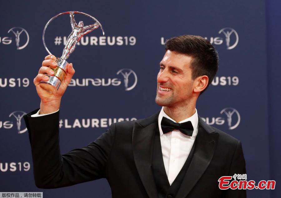 Tennis star Novak Djokovic poses after winning the Sportsman of the Year award at Laureus World Sports Awards in Salle des Etoiles, Monaco, Feb. 18, 2019. (Photo/Agencies)