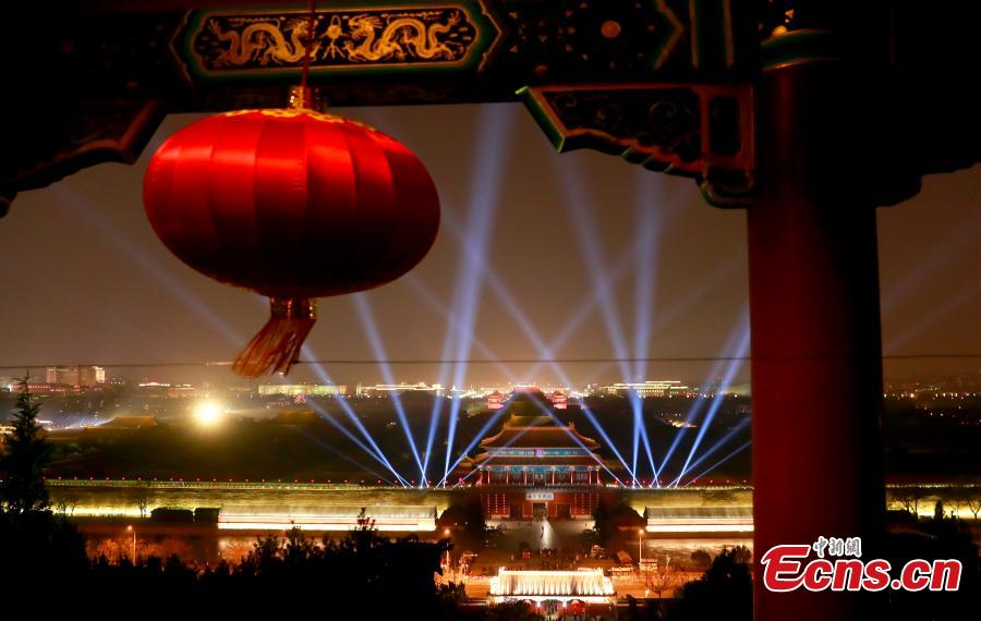 The Palace Museum is lit up on Feb. 18 evening for a rehearsal of rare nighttime public tours on Feb. 19 and Feb. 20 for visitors who were able to snag the free tickets. (Photo: China News Service/Du Yang)