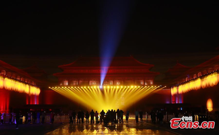 Employees adjust lights at the Palace Museum, Feb. 18, 2019. Tuesday marks the traditional Chinese Lantern Festival. To celebrate the festival, the Palace Museum opens to the public at night for the first time in 94 years. The celebration features a red lantern show, light projection for renowned ancient paintings as well as New Year-themed exhibitions inside the grand palace cluster.  (Photo: China News Service/Du Yang)
