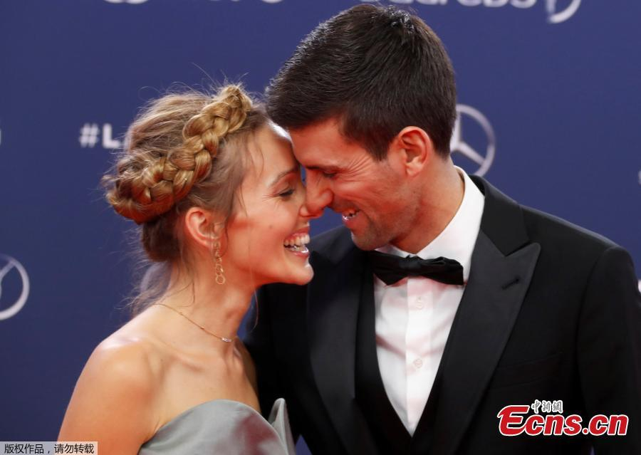 Tennis star Novak Djokovic poses with Jelena Dokovic as they arrive at the ceremony at Laureus World Sports Awards in Salle des Etoiles, Monaco, Feb. 18, 2019. (Photo/Agencies)