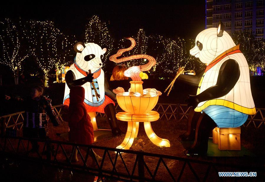 Photo taken on Feb. 17, 2019 shows panda-themed lanterns near the Gongshui River in Xuan\'en County of Enshi Tujia and Miao Autonomous Prefecture, central China\'s Hubei Province. With the approaching of the Lantern Festival, many places across the country are decorated by colorful lanterns. (Xinhua/Song Wen)