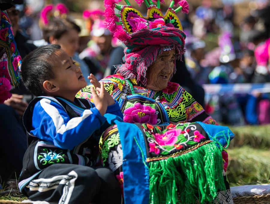 Villagers watch the Dress Contest Festival on Feb. 19, 2019. (Photo/Xinhua)