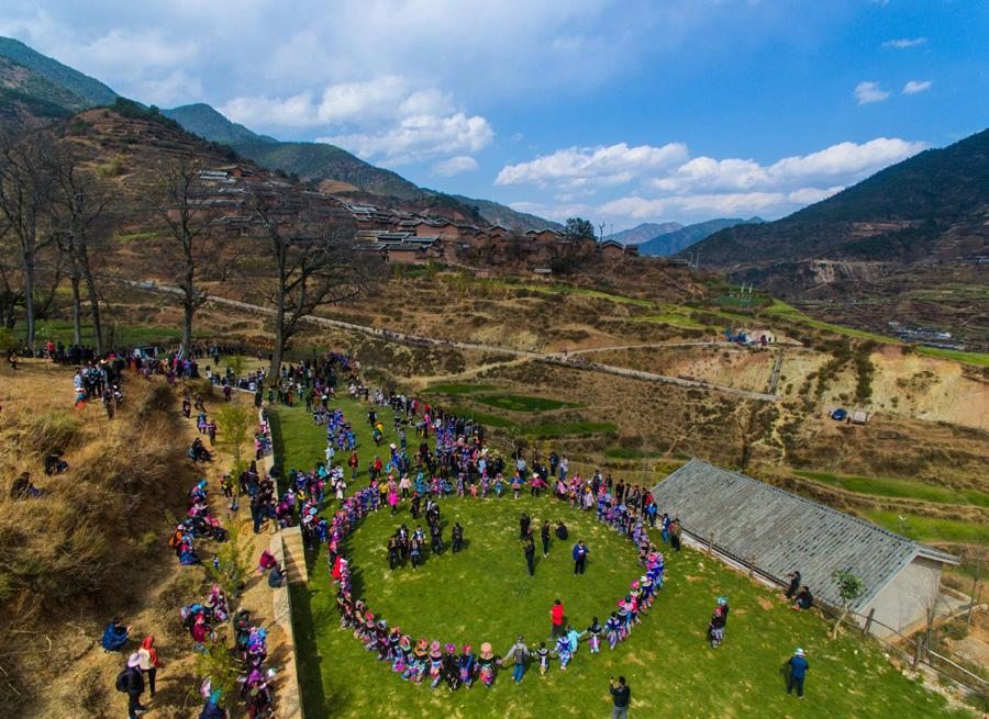An aerial photo shows the scene of people dancing with visitors at the festival on Feb. 19, 2019. (Photo/Xinhua)