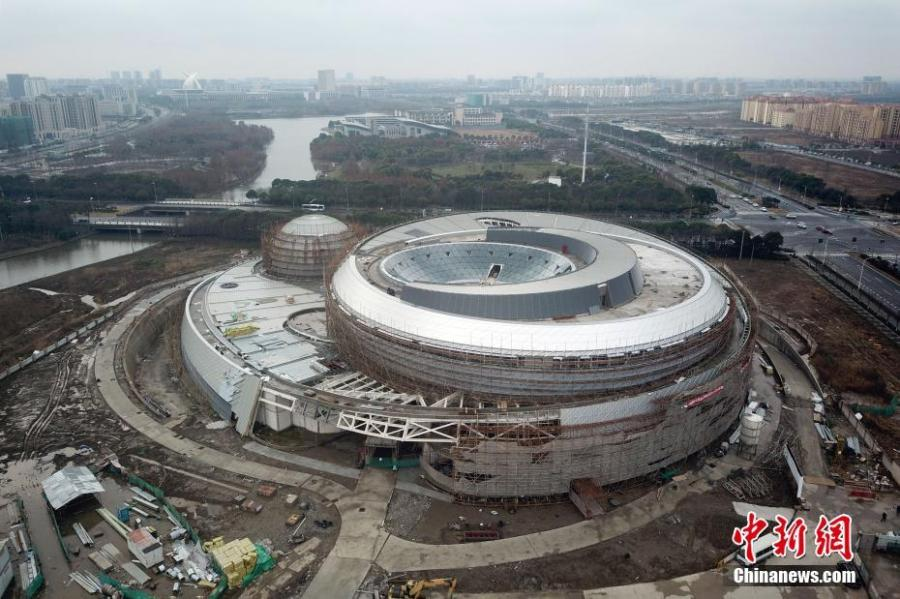 An aerial photo shows the Shanghai Planetarium on Feb. 20, 2019. All of the main steel structure projects of the Shanghai Planetarium were completed on Tuesday. Located in Lingang in Pudong New Area, the Shanghai Planetarium will be the world\'s largest with a total area of 38,164 square meters when it officially opens in 2020. The main idea behind the design of the planetarium is influenced by astronomical principles like orbital motion. (Photo: China News Service/Zhang Hengwei)