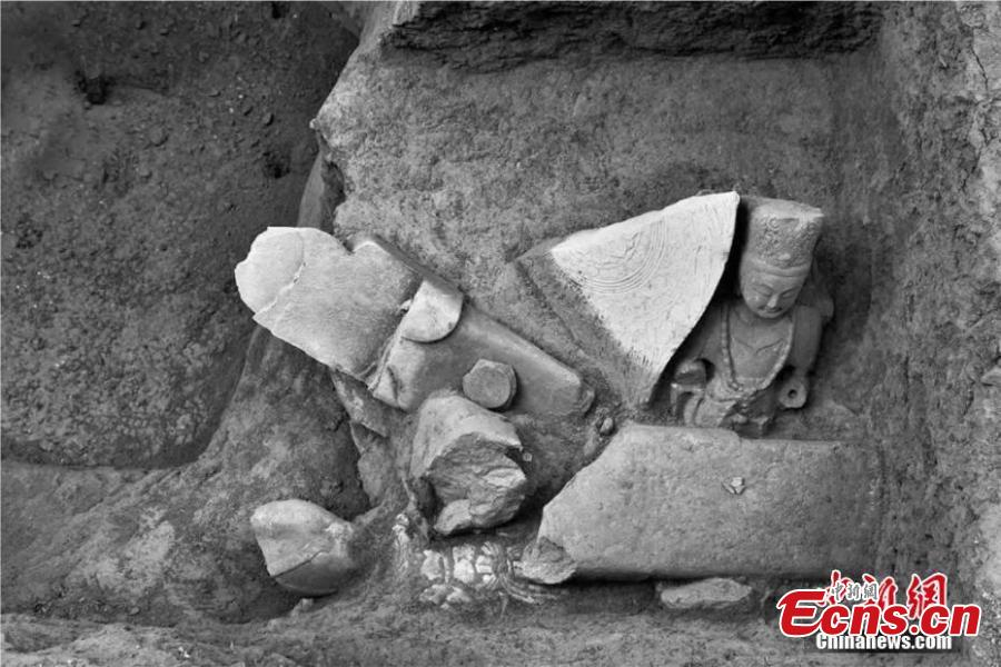 This photo provided by the Shanxi Provincial Institute of Archaeology on Feb. 20, 2019 shows a pit filled with Buddha statues discovered in Xizhou City, Shanxi Province, close to the sacred Buddhist mountain Wutai. The institute said a total of 34 Buddha statues, made in the period from the Northern Wei Dynasty (386-534) to the Tang Dynasty (1368-1644), have been found during six years of excavation work. Archeologists said the statues were possibly buried during the Tang Dynasty, when there was a crackdown on Buddhism. (Photo provided to China News Service)