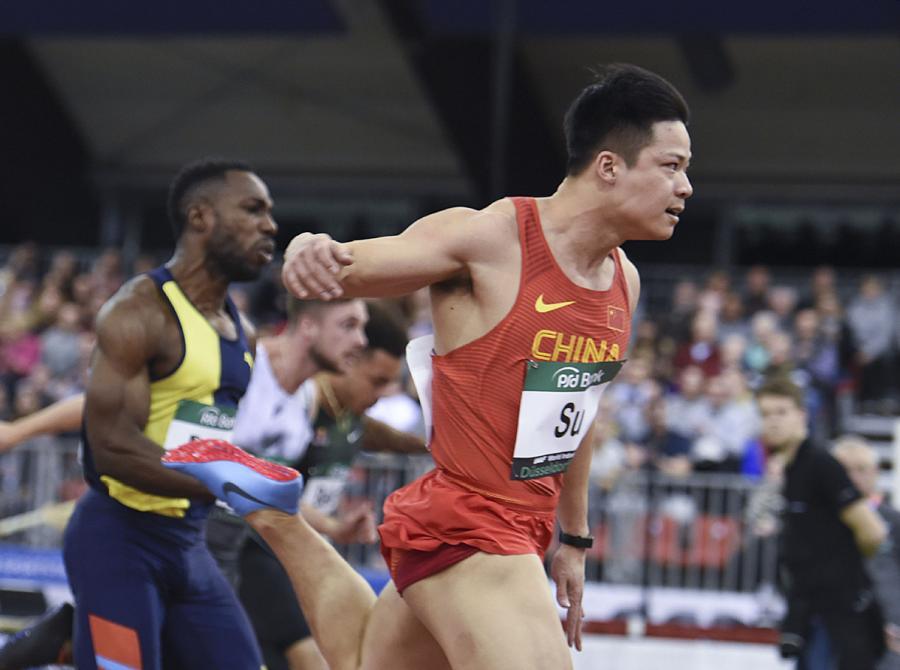China\'s Su Bingtian crosses the finish line during the men\'s 60 meters in Dusseldorf, Germany, on Feb. 21, 2019. (Photo/Xinhua)