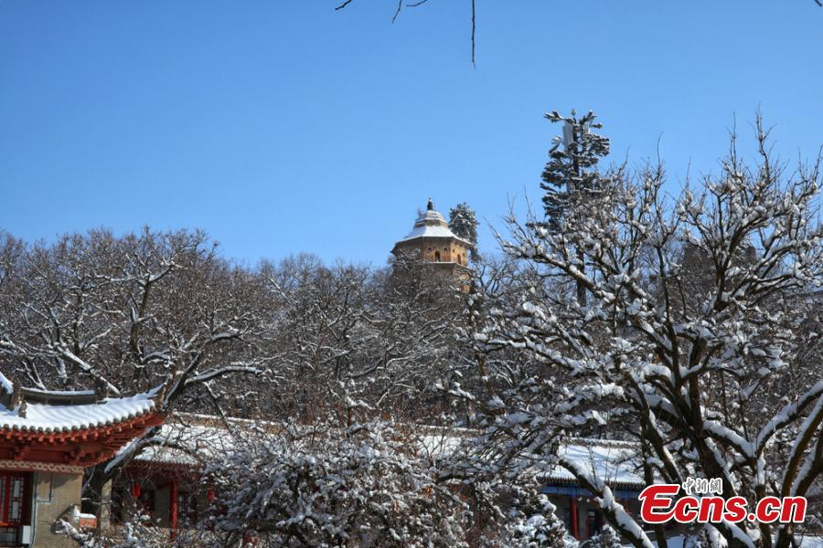 A view of the snow-covered Kongtong Mountain, one of the sacred mountains of Taoism, in Pingliang City, Gansu Province in mid-February. The spot is noted for its marvelous natural scenery and is referred to as \